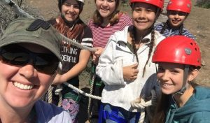 Students and Teacher Zip Line Fun